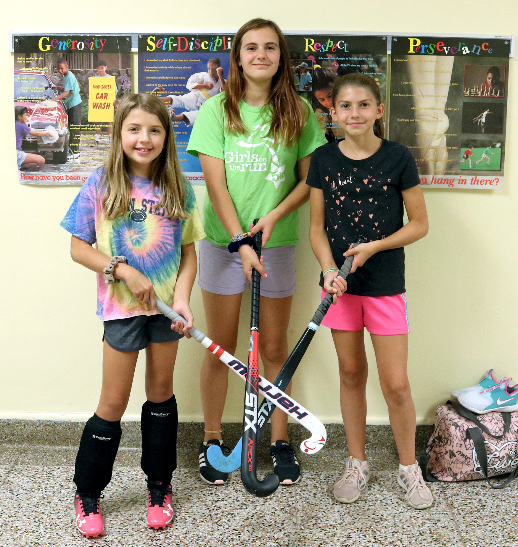Three field hockey players