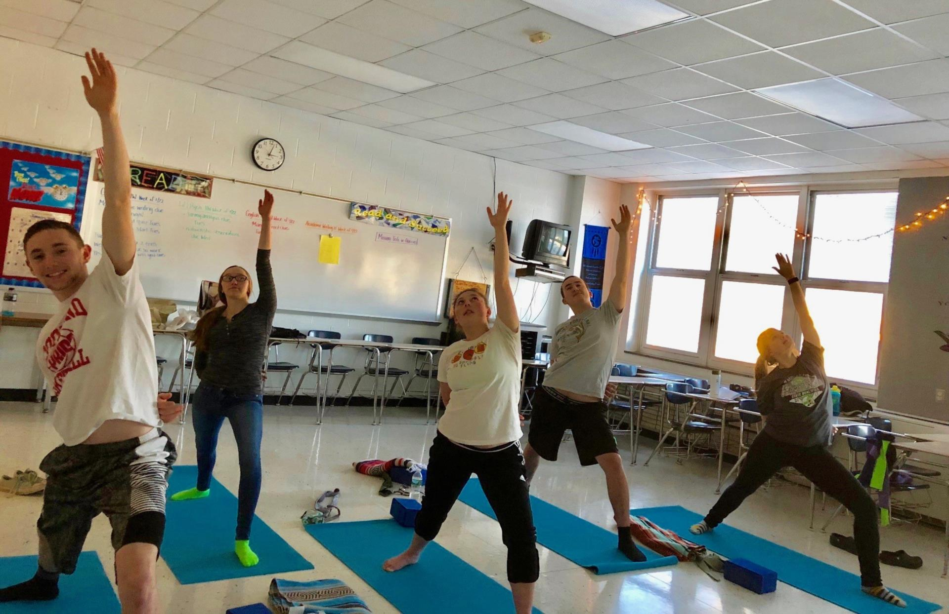 Students practicing yoga.