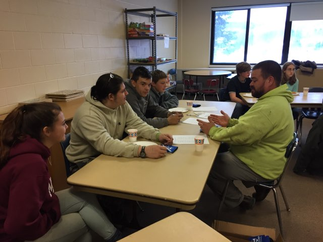 Image of students talking to career cafe professional