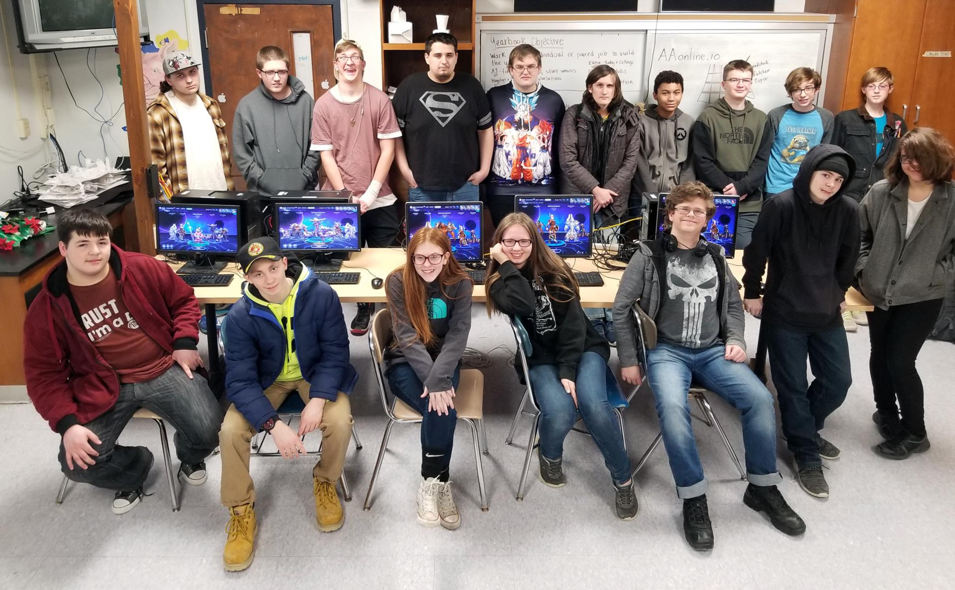 NHS students posing with computers