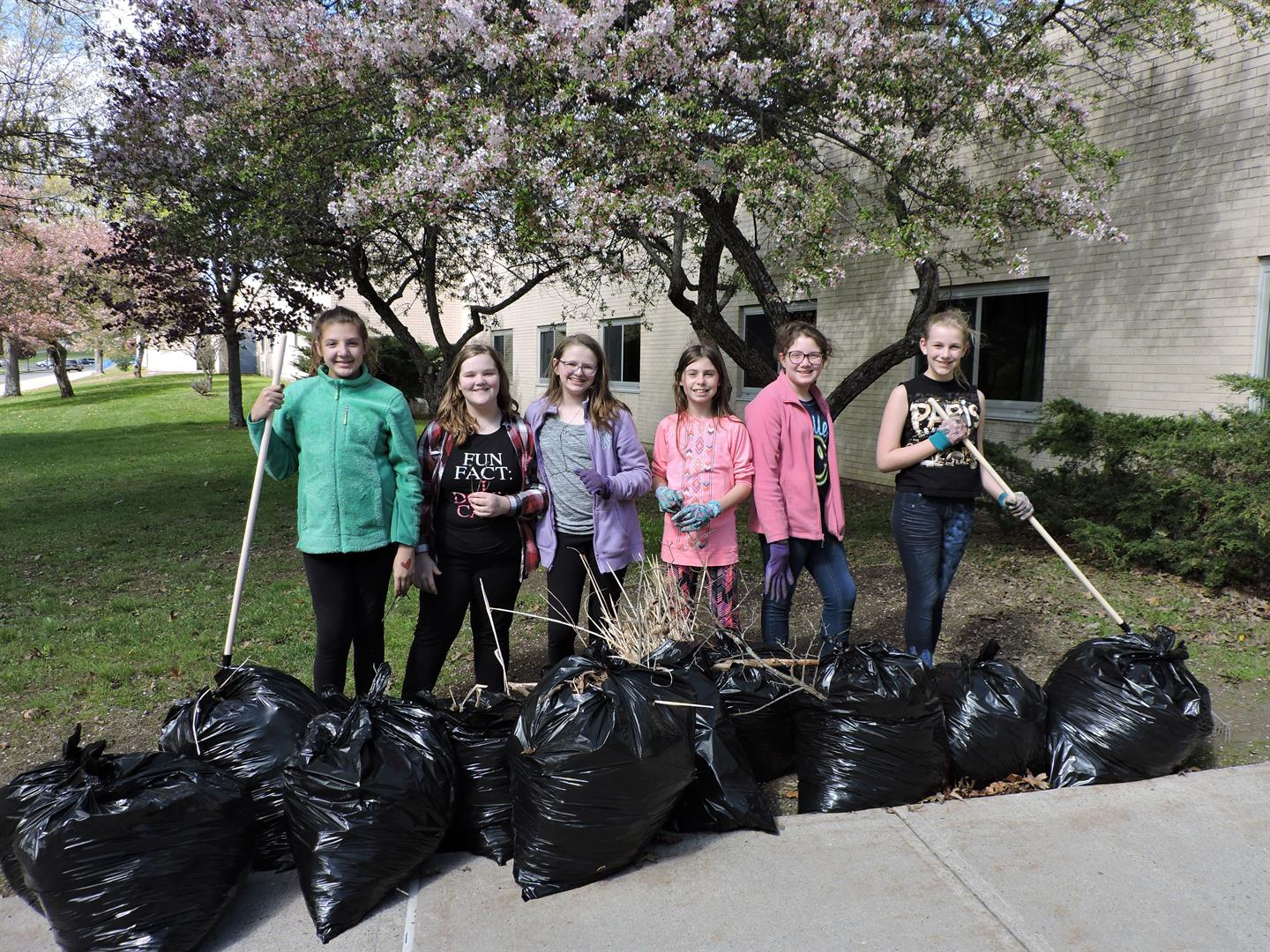 6th Grade Students Help to Clean the Entrance to the Middle School