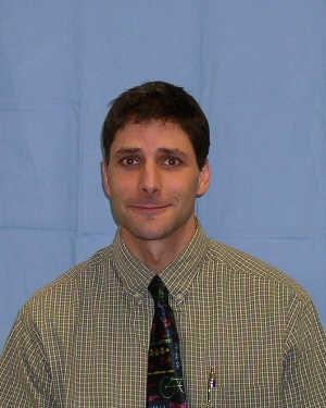 Principal Walt Baskin wearing tie