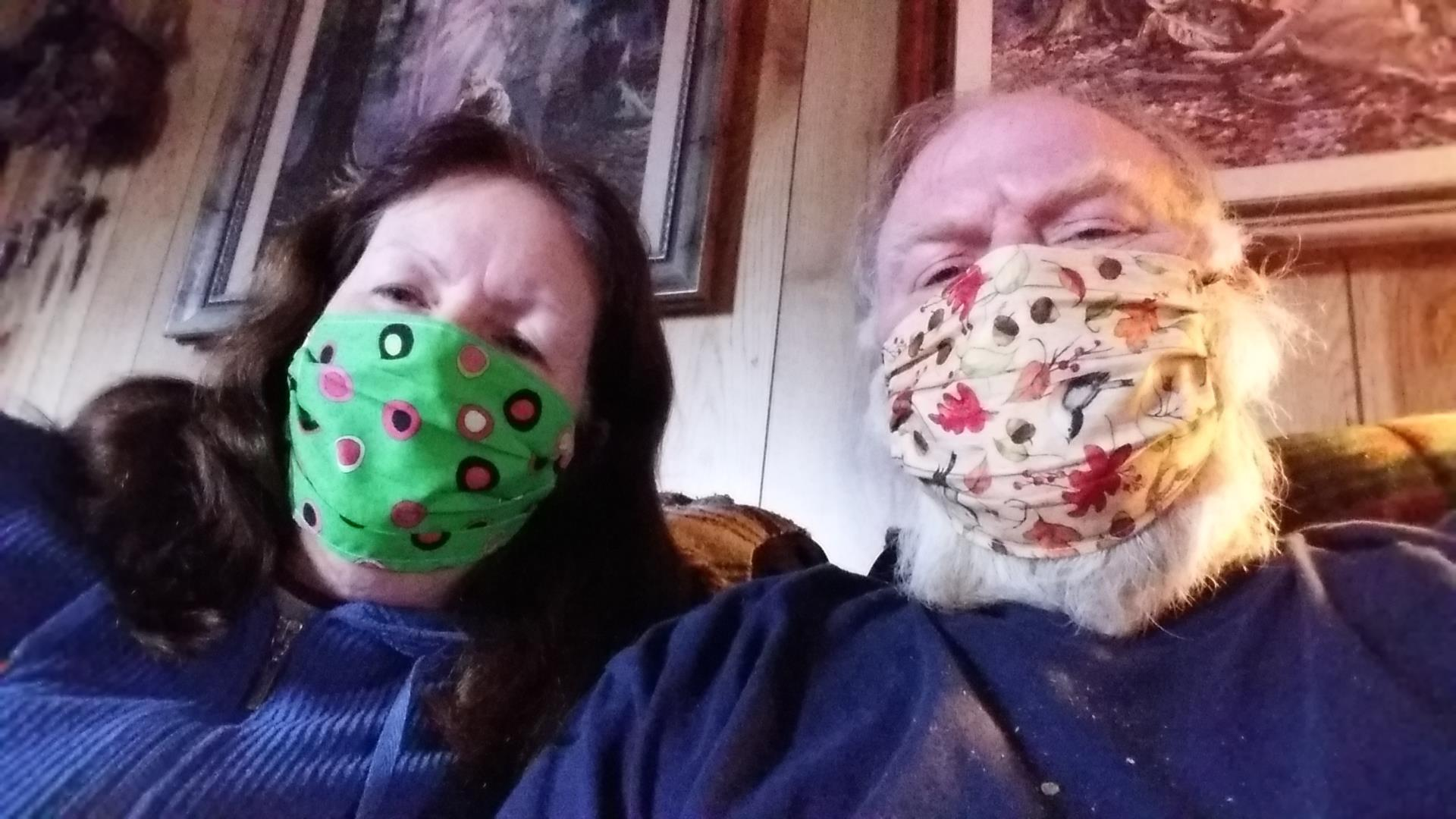 A man and woman wearing face masks