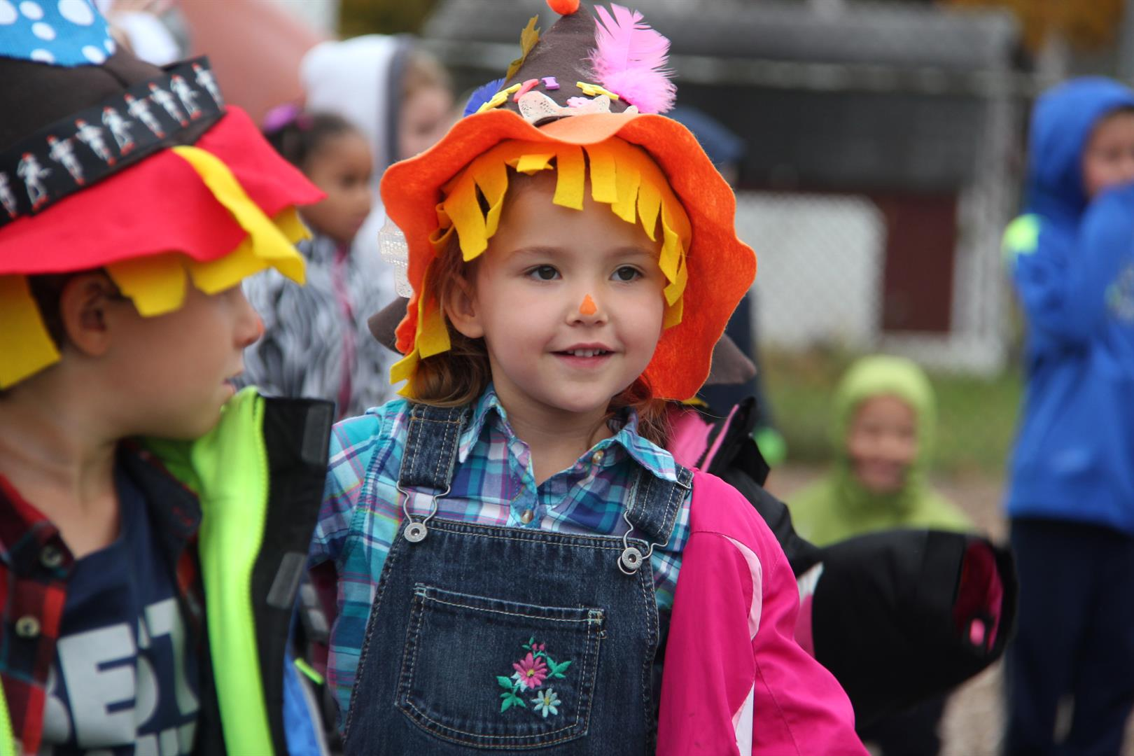 girl dressed as scarecrow smiling