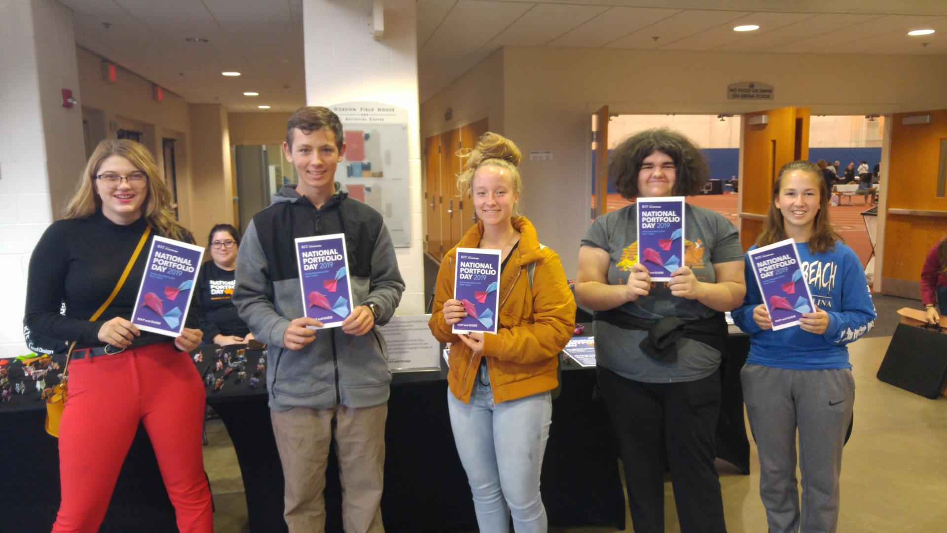 Fivie students hold up fliers for National Portfolio Day