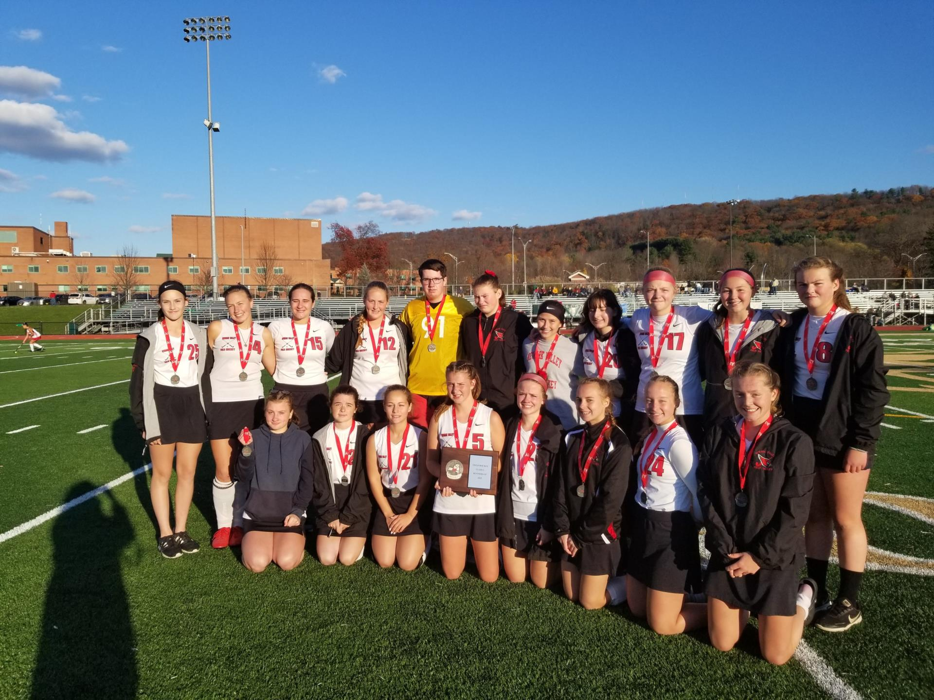 NV Field Hockey Team with ribbons on field