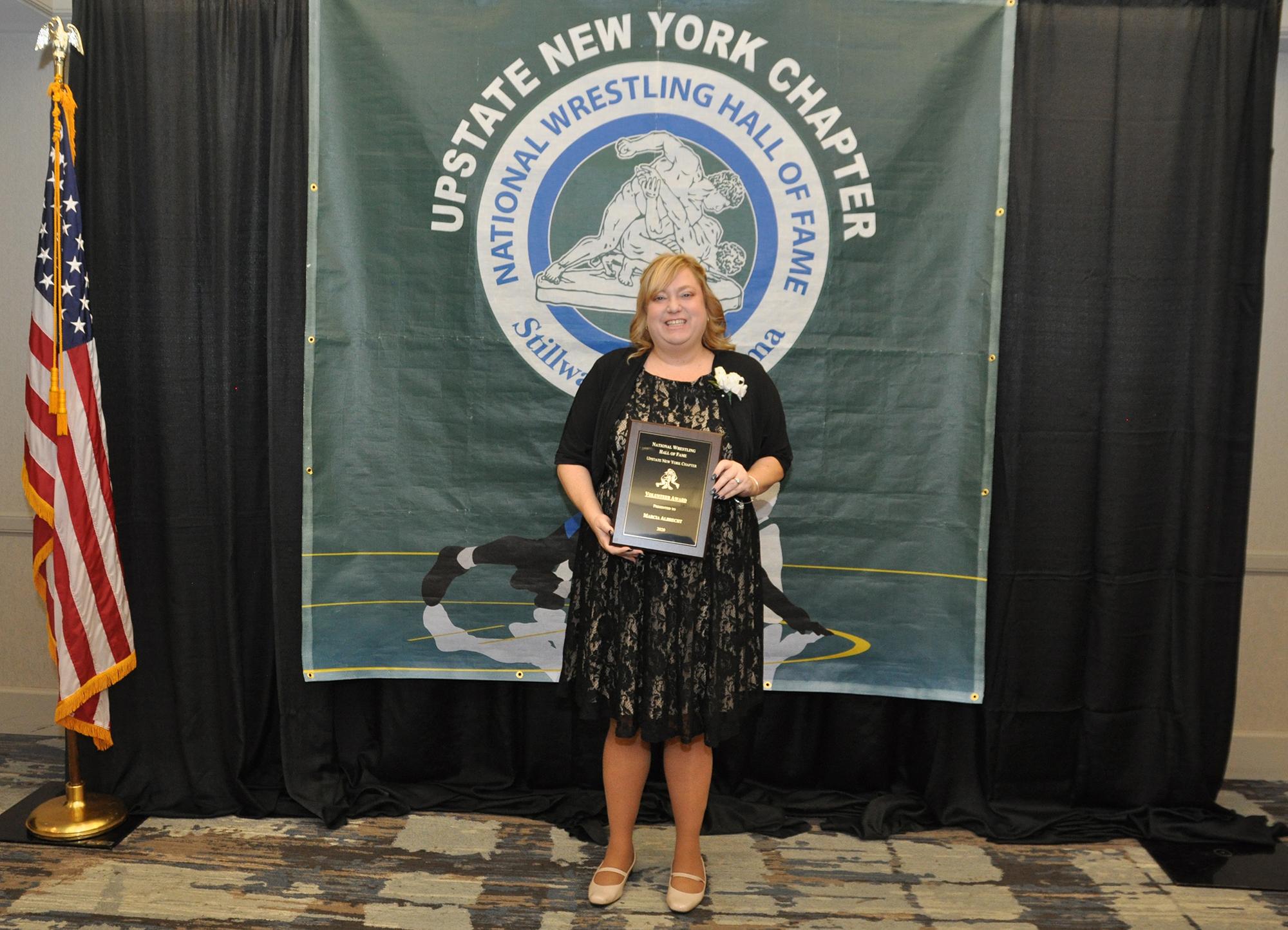 Walton teacher honored by wrestling hall