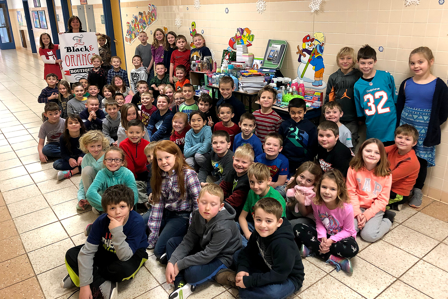Second graders with their donations to the Black and Orange Boutique