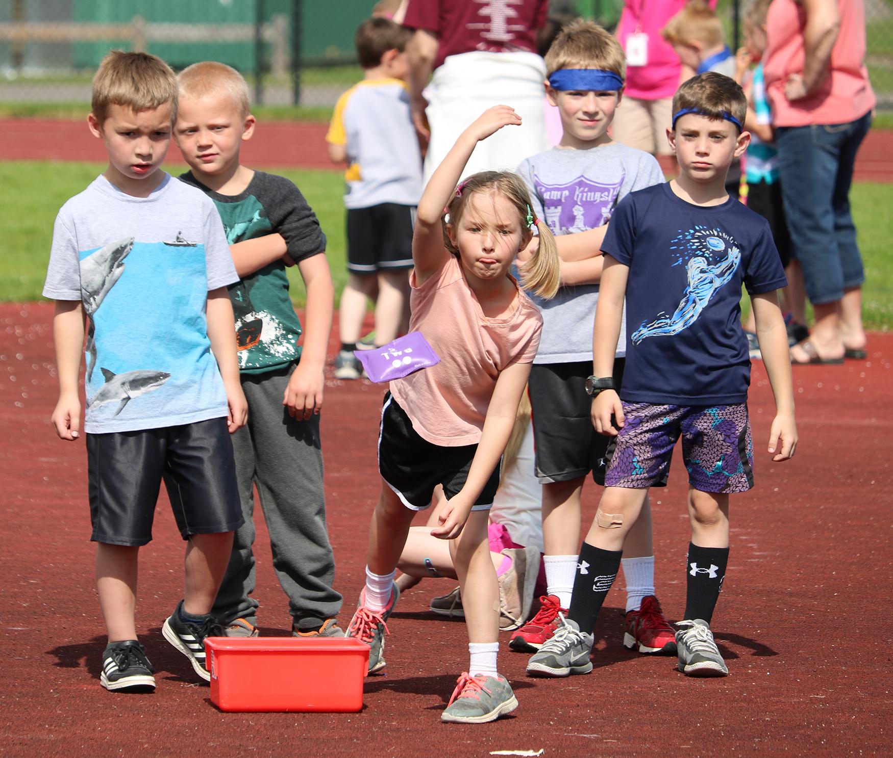 Kids playing bean-bag toss (10/2020)