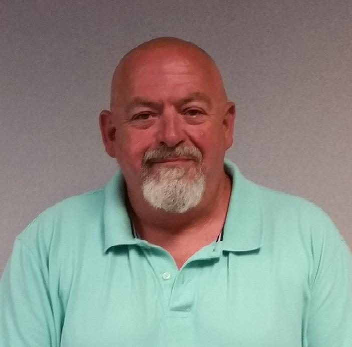 smiling man in green shirt