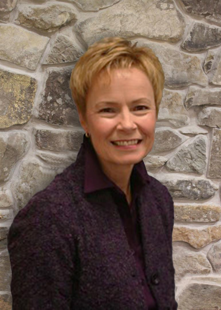 smiling woman with short blonde hair and jacket