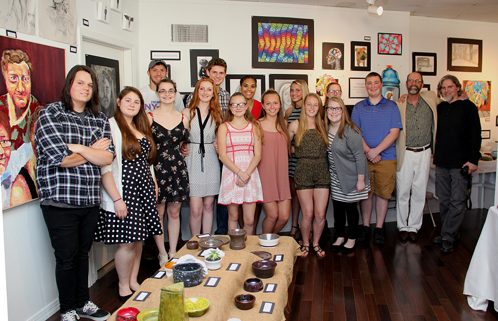 Seniors at art show with teachers