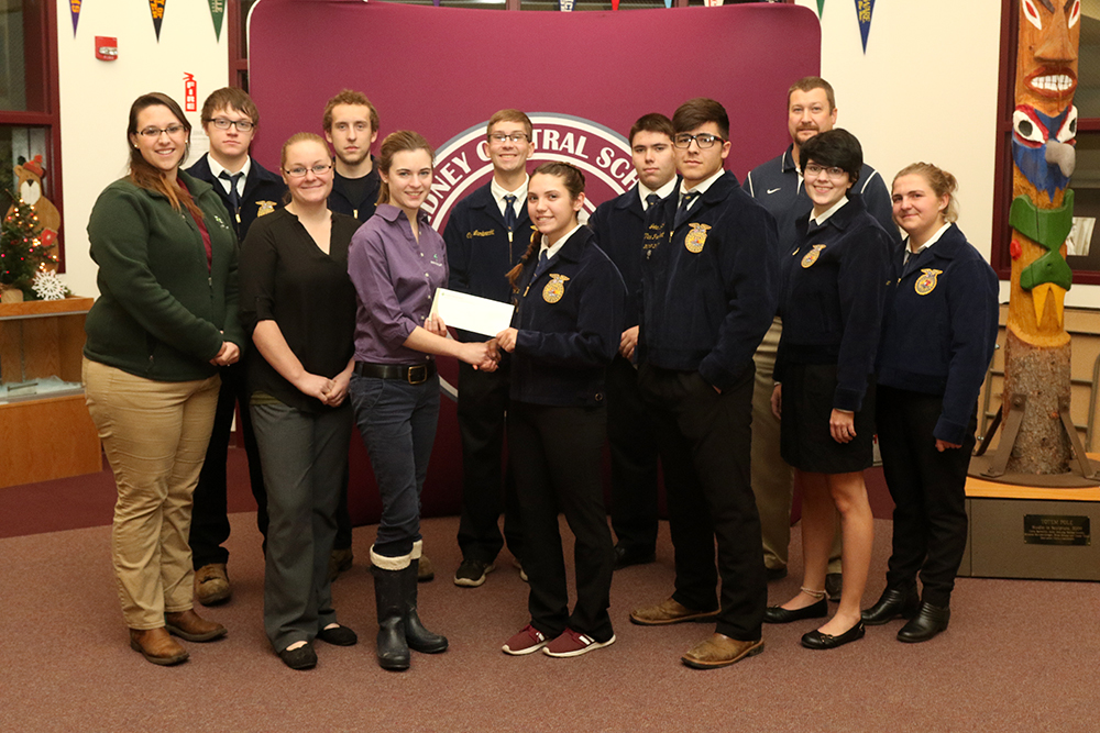 Sidney FFA officers receive a donation from Farm Credit East representatives