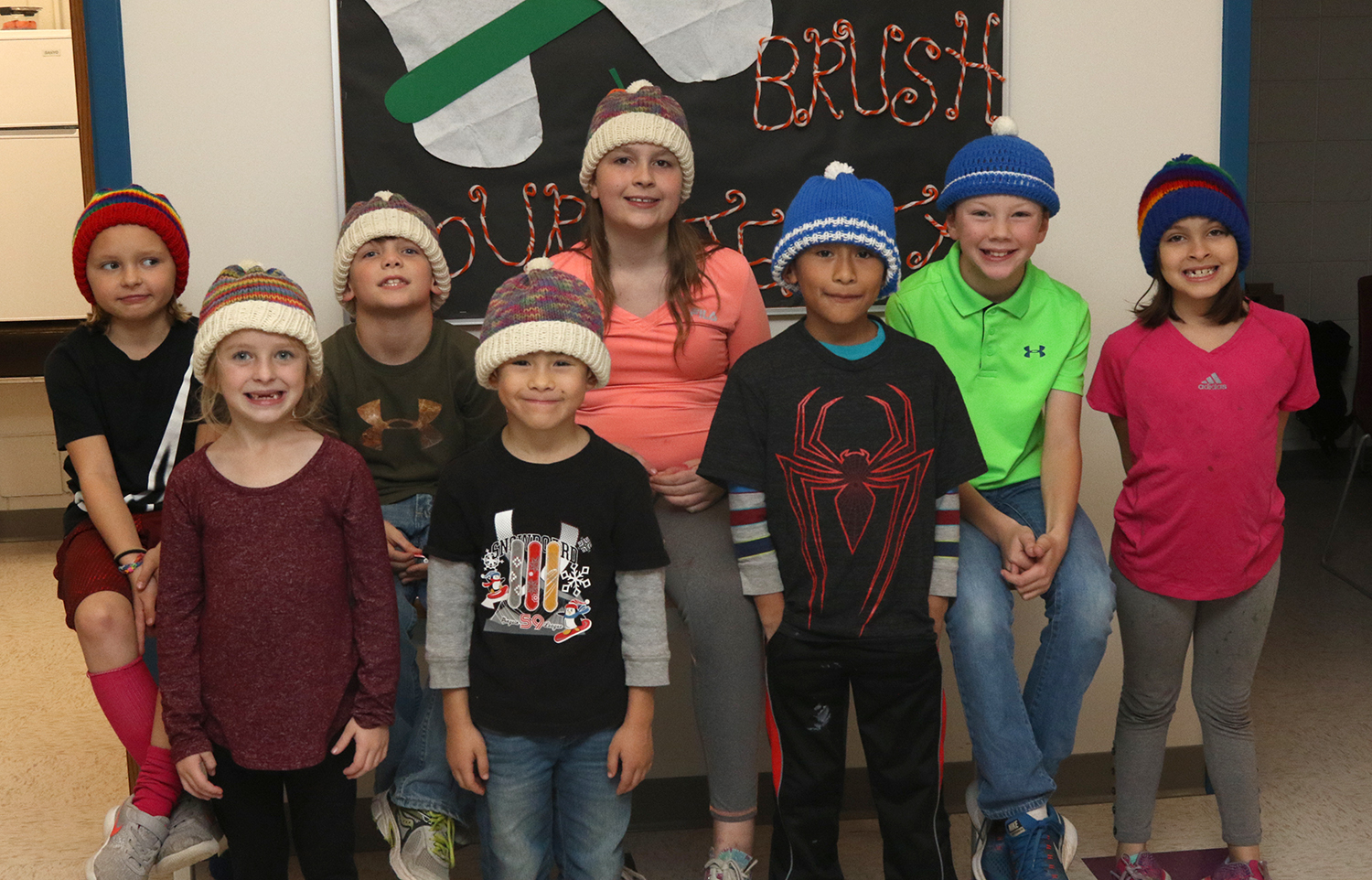 Students wearing donated hats