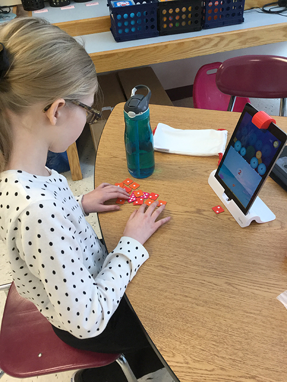 Student using the new Osmo system.