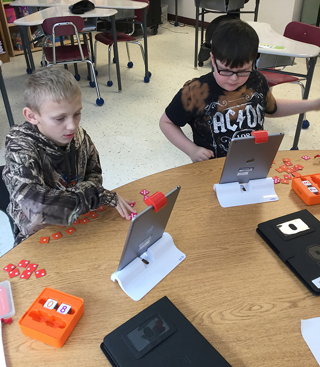Students using the new Osmo system.