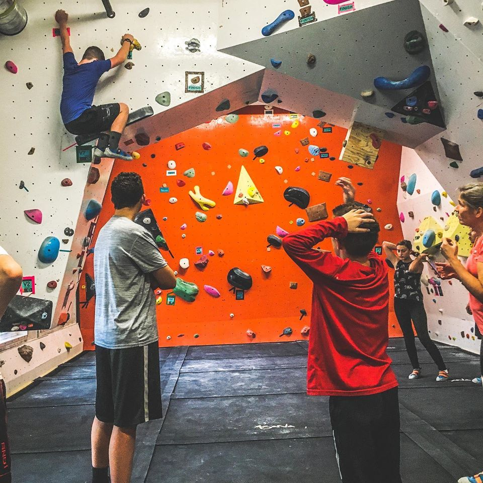 students wall climbing