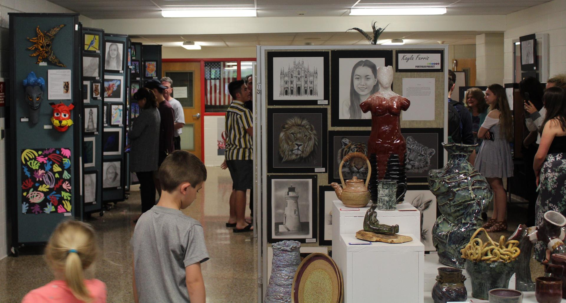 people at chenango valley middle school and high school art show