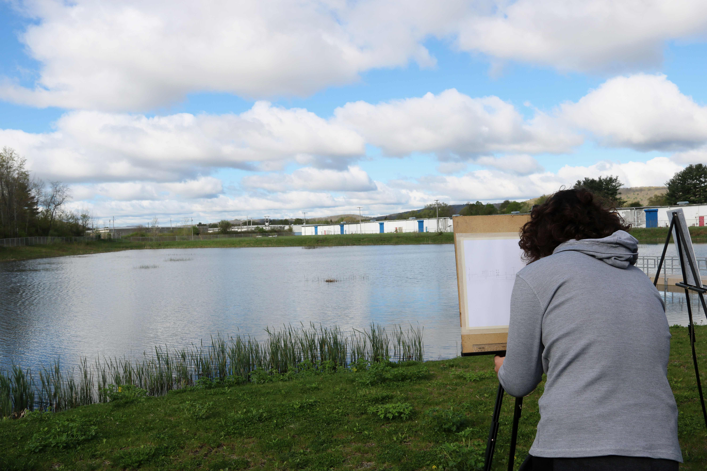 student painting landscape