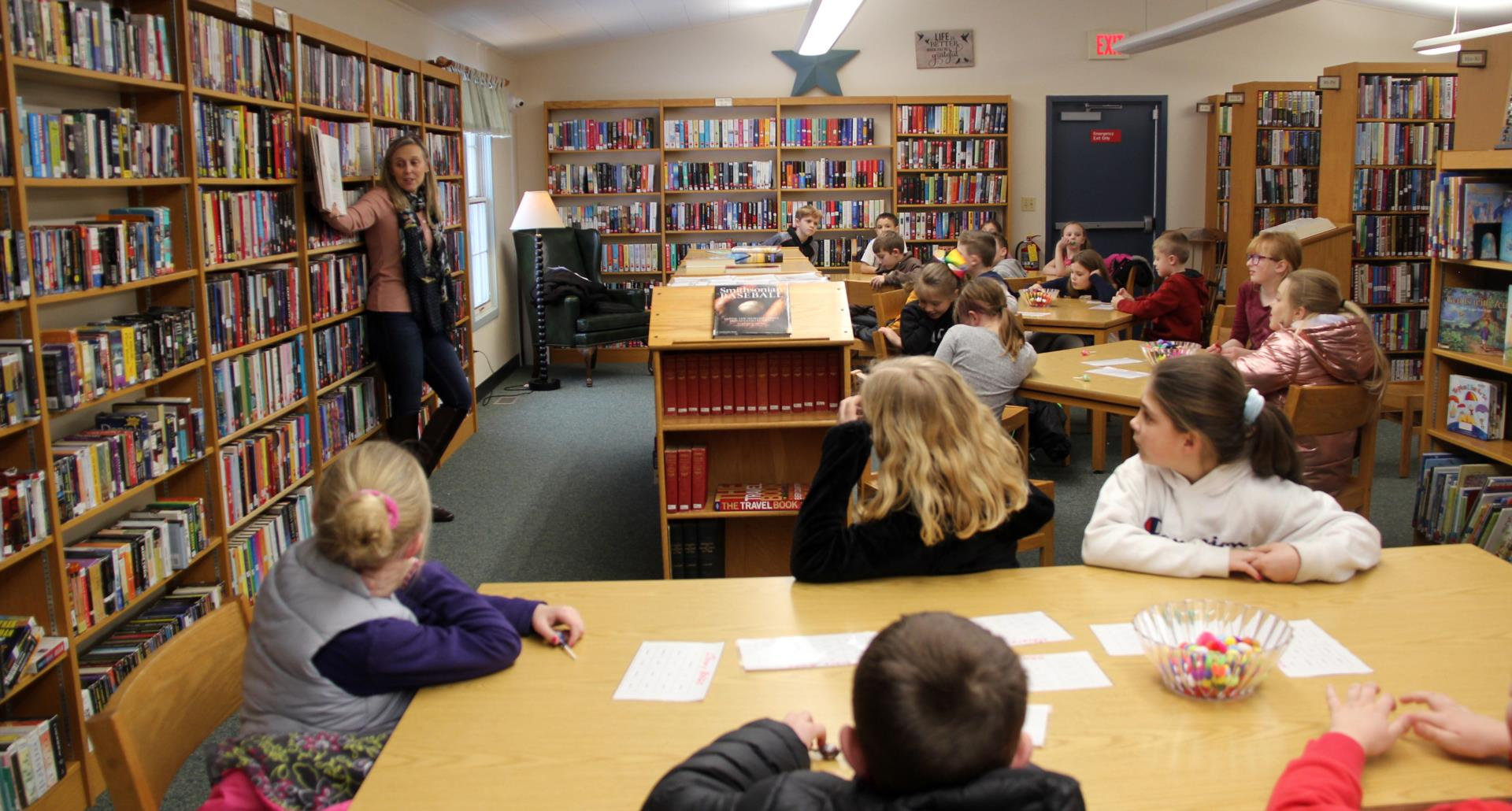 library director reading to students
