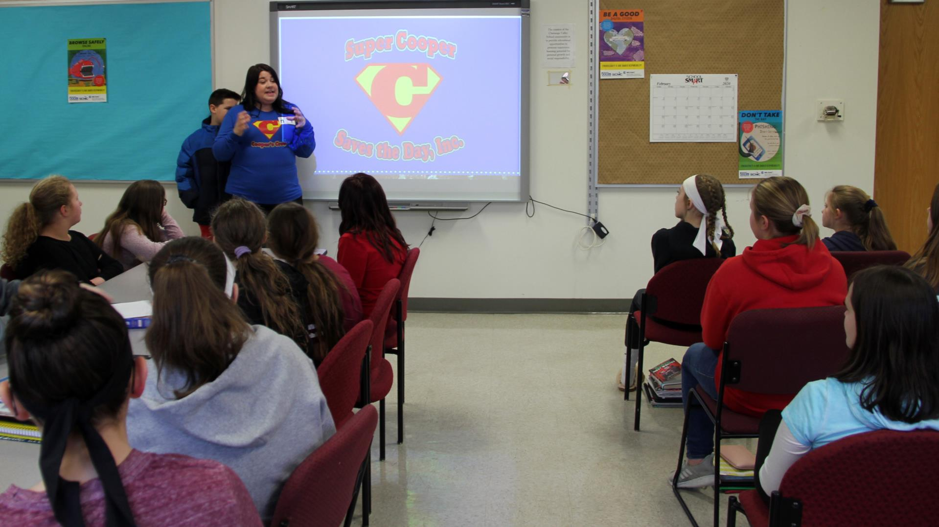 presenter speaking with middle school students