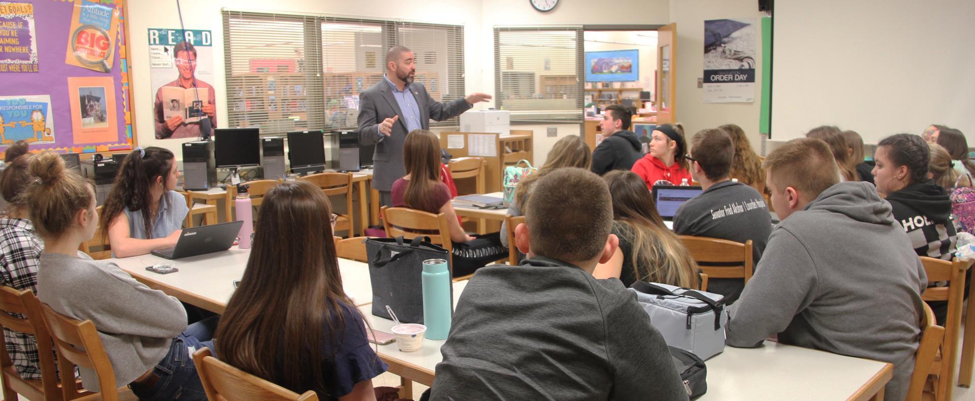 senator akshar speaking with students