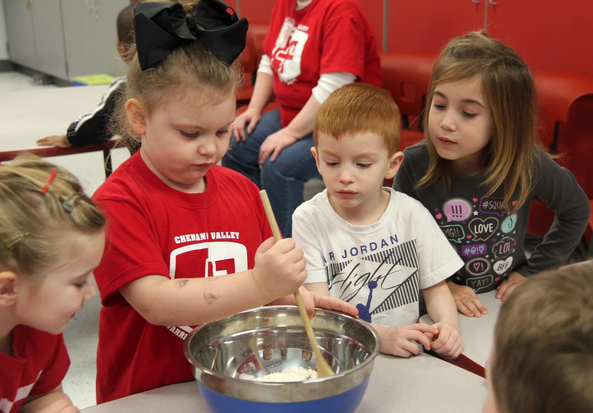 additional student mixing playdough