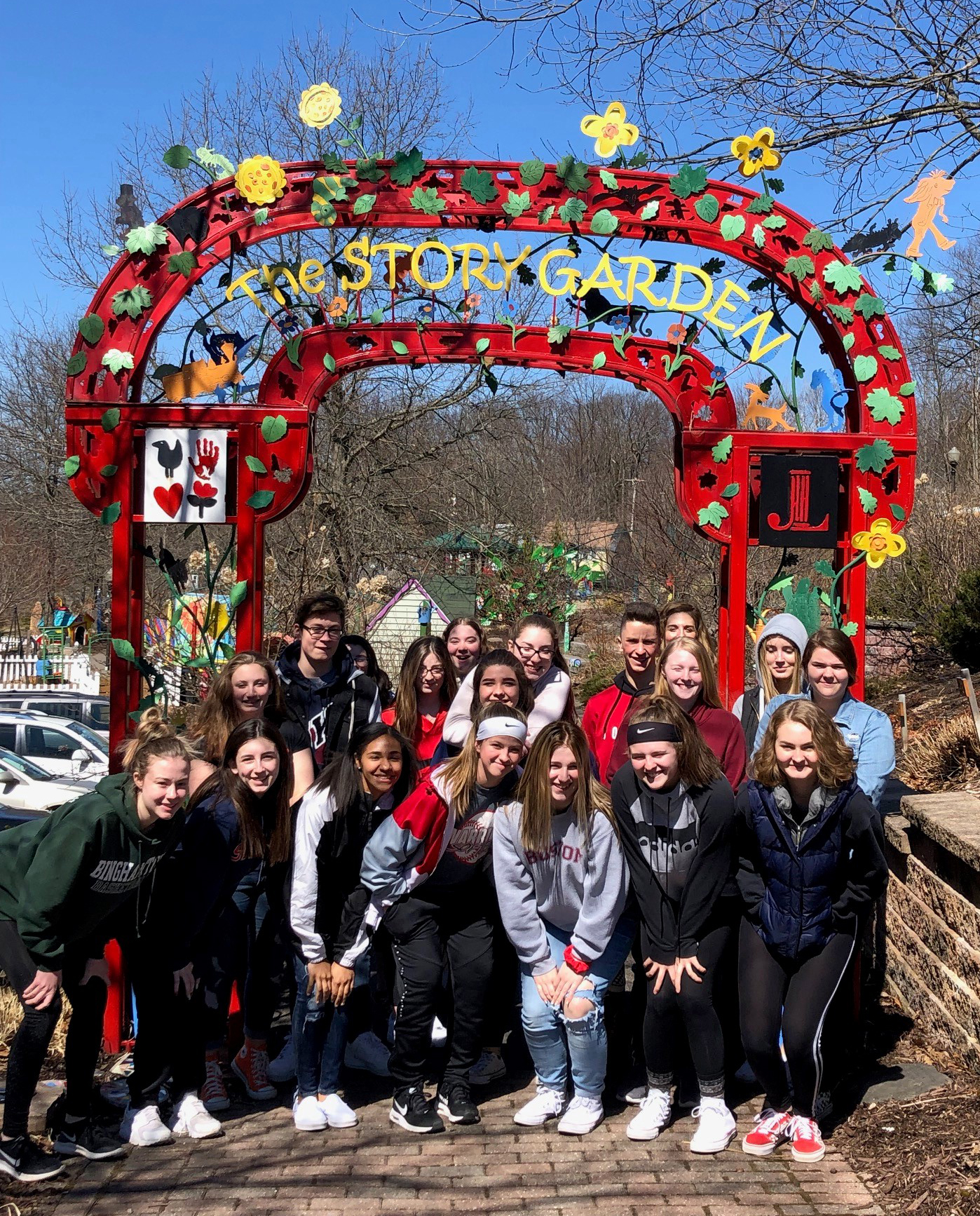 class in front of the story garden sign