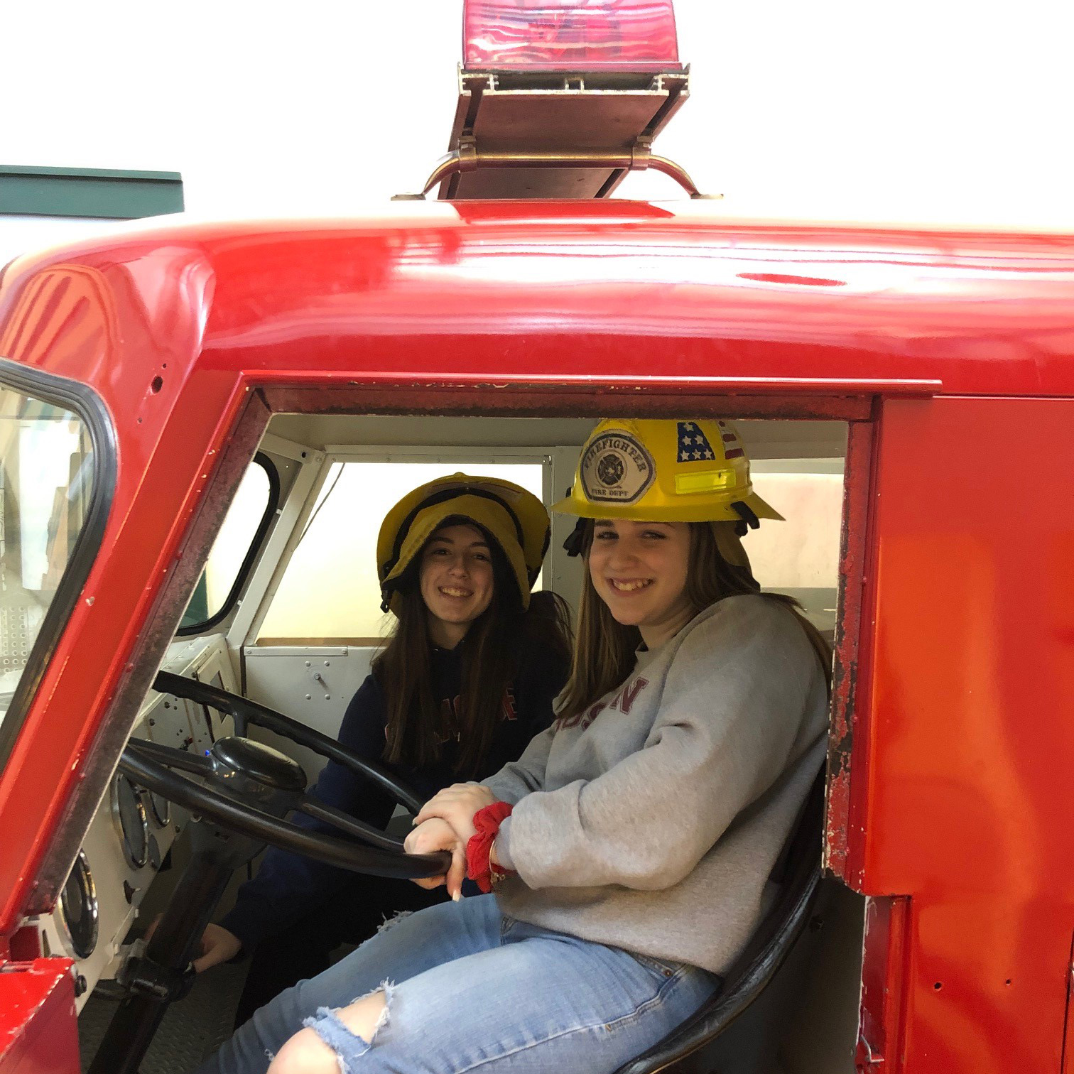 students inside of fire truck prop