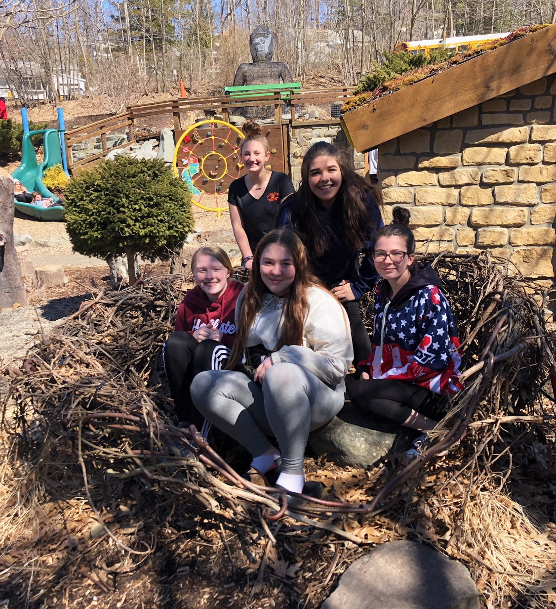 students in story garden bird nest