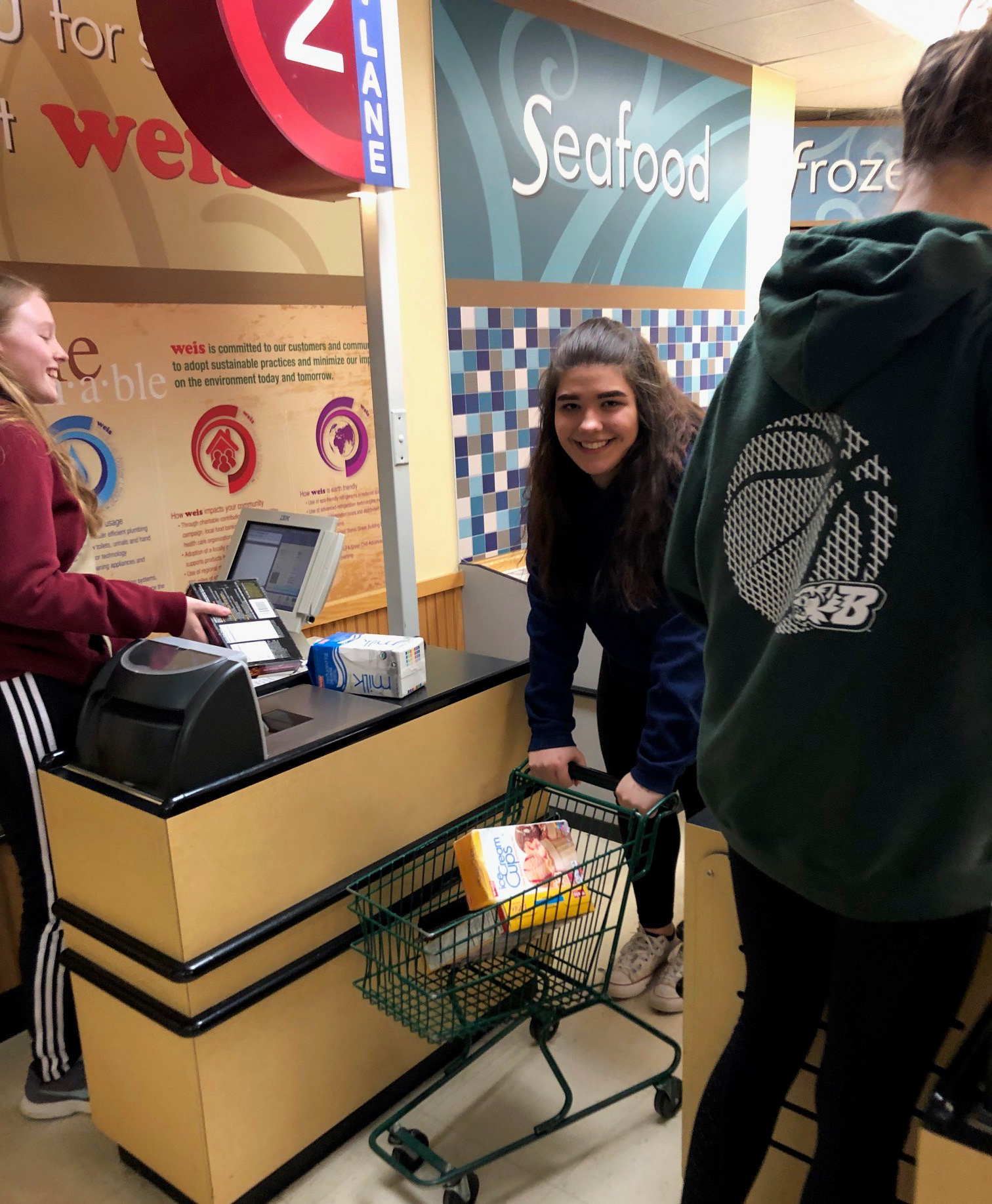 students inside of discovery center grocery store