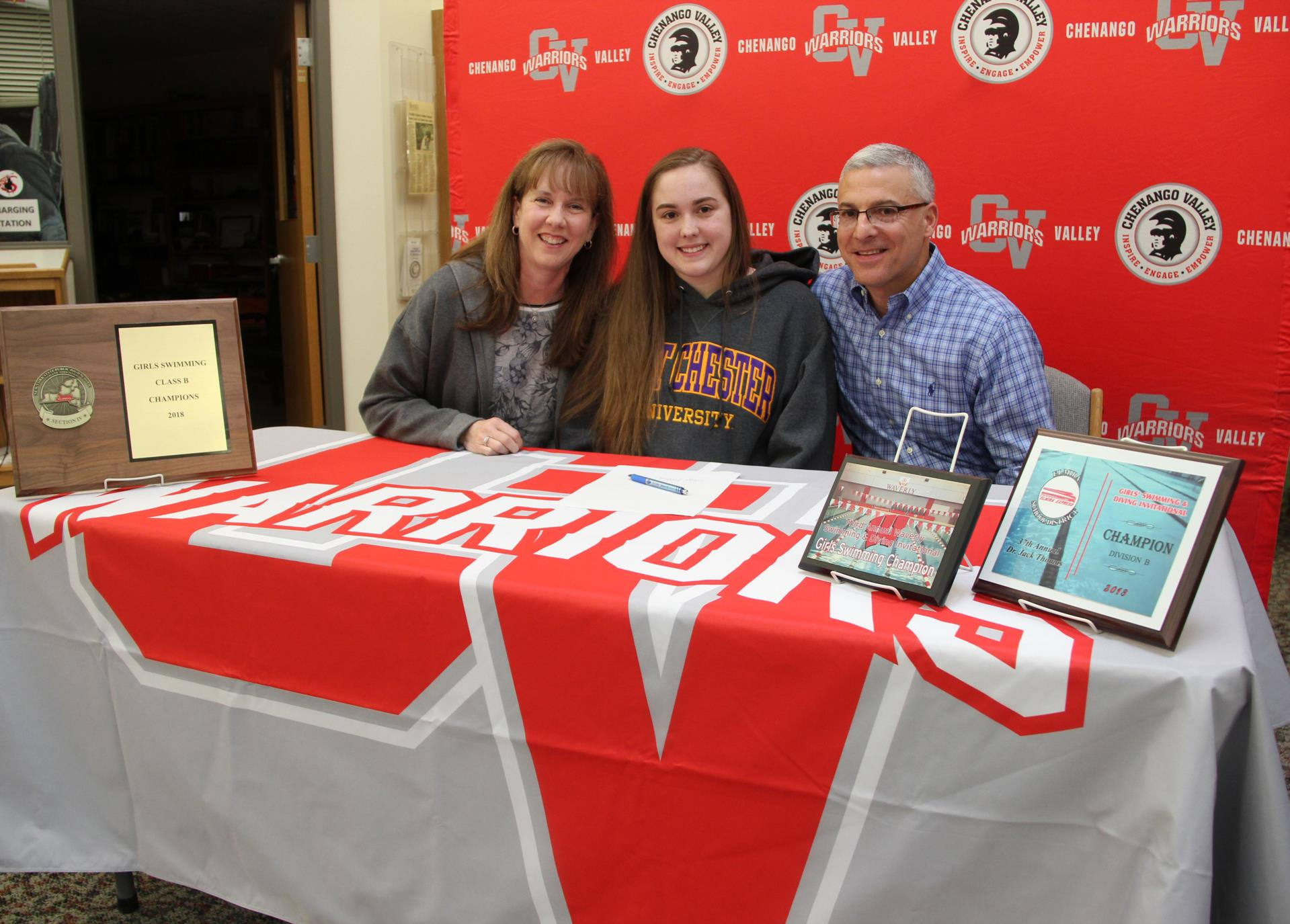 paige lettera and family members at signing