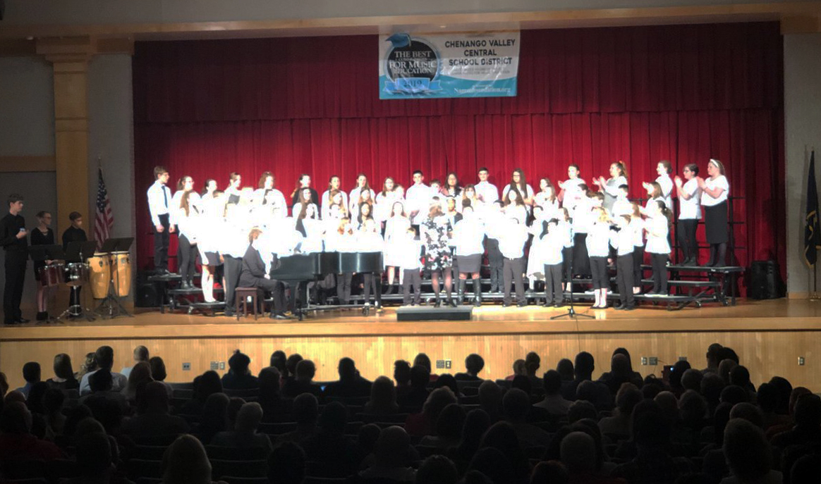 more students singing in spring concert