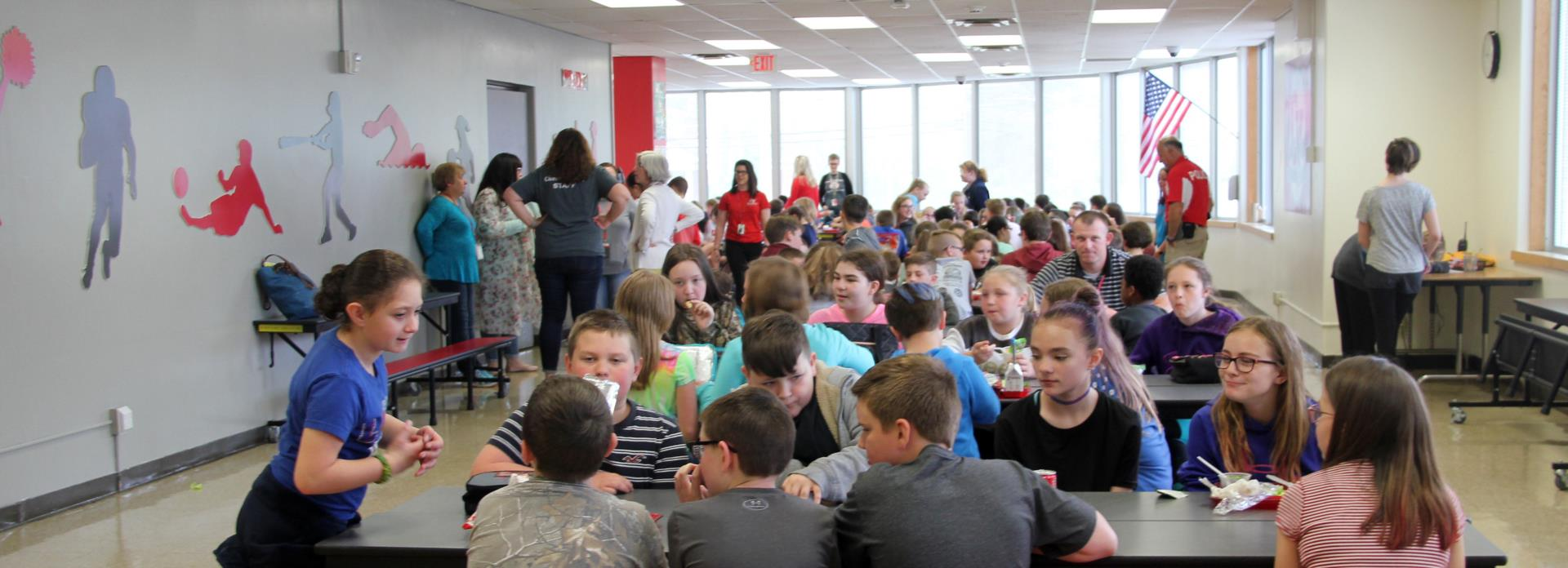 wide shot of students eating in cafeteria