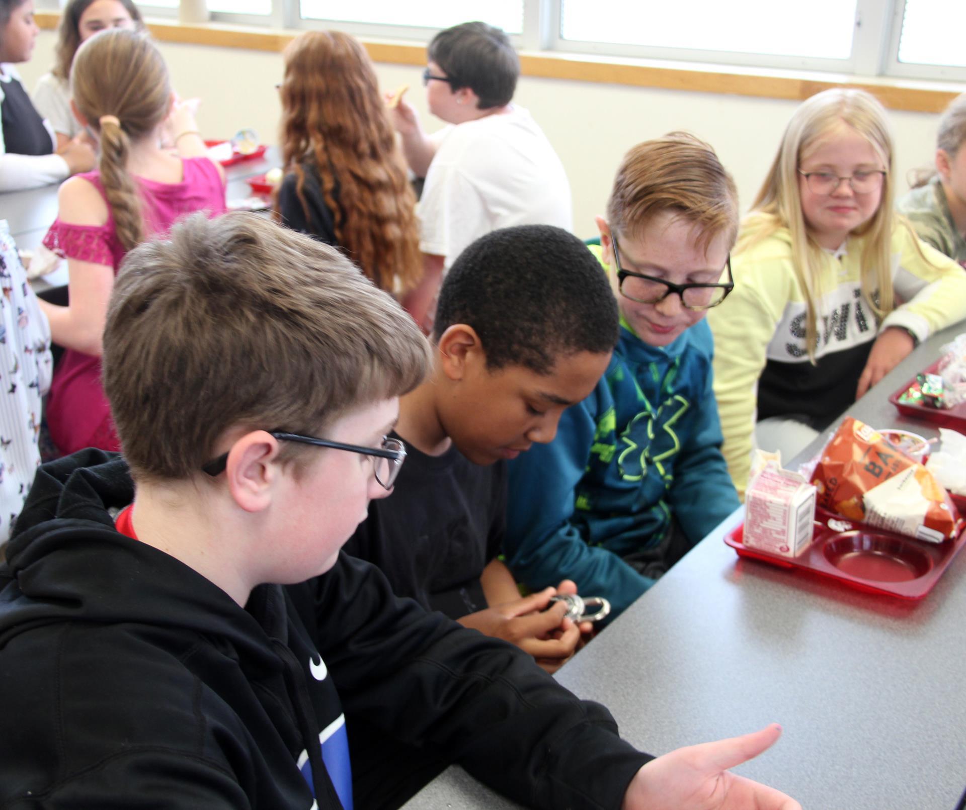 students looking at lock