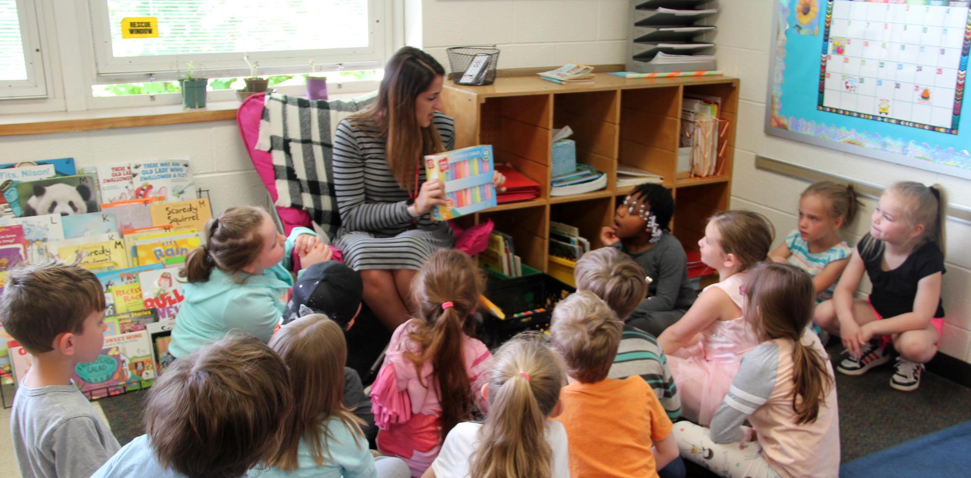 teacher showing class gifts