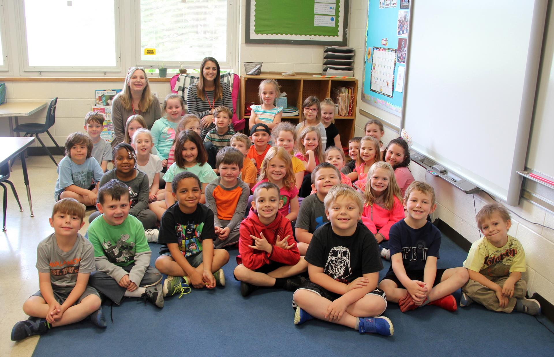 both classes sitting together smiling