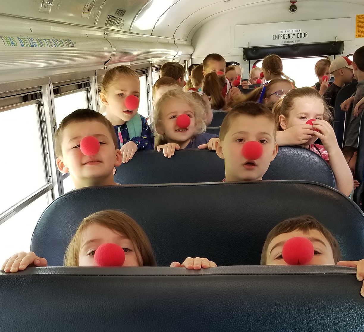 students wearing red noses on school bus