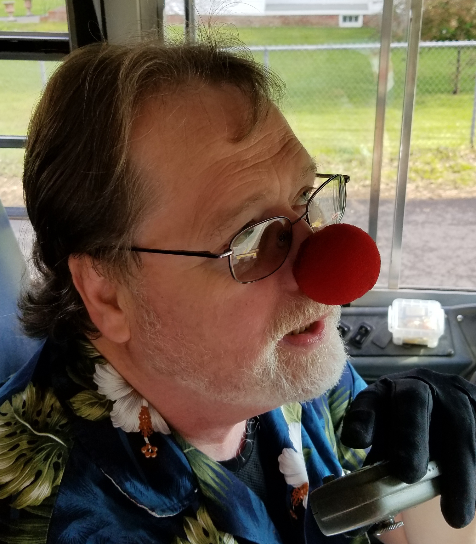 bus driver wearing red nose