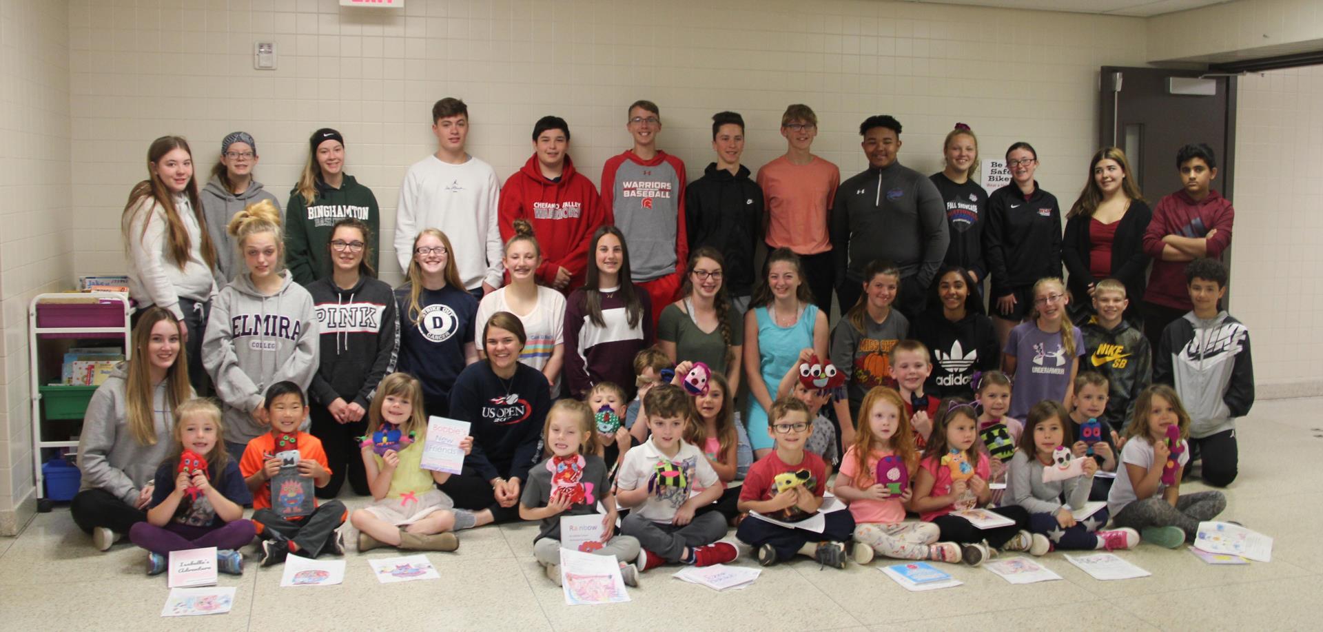 middle school, high school and kindergarten students in hallway