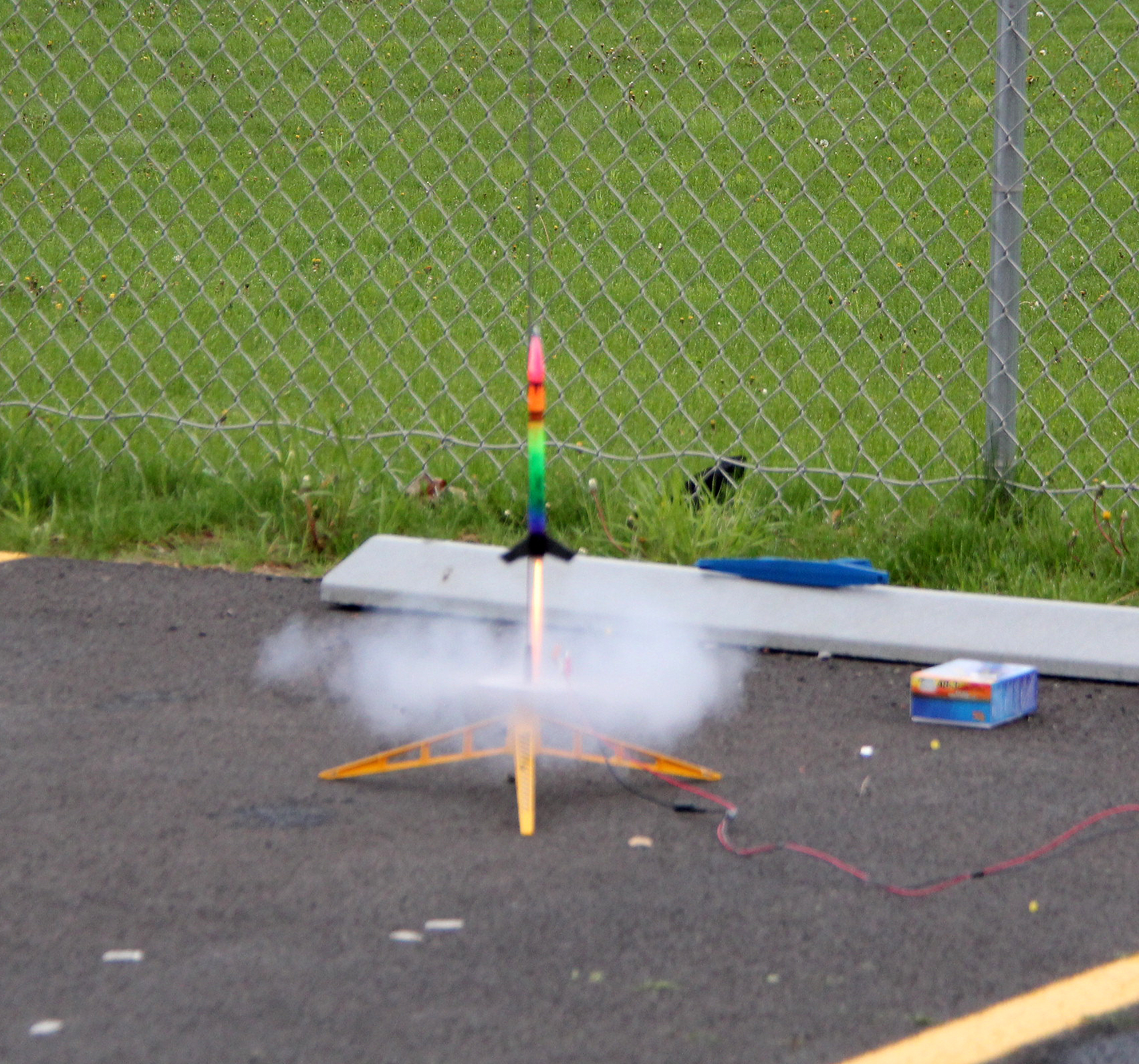 model rocket beginning to launch