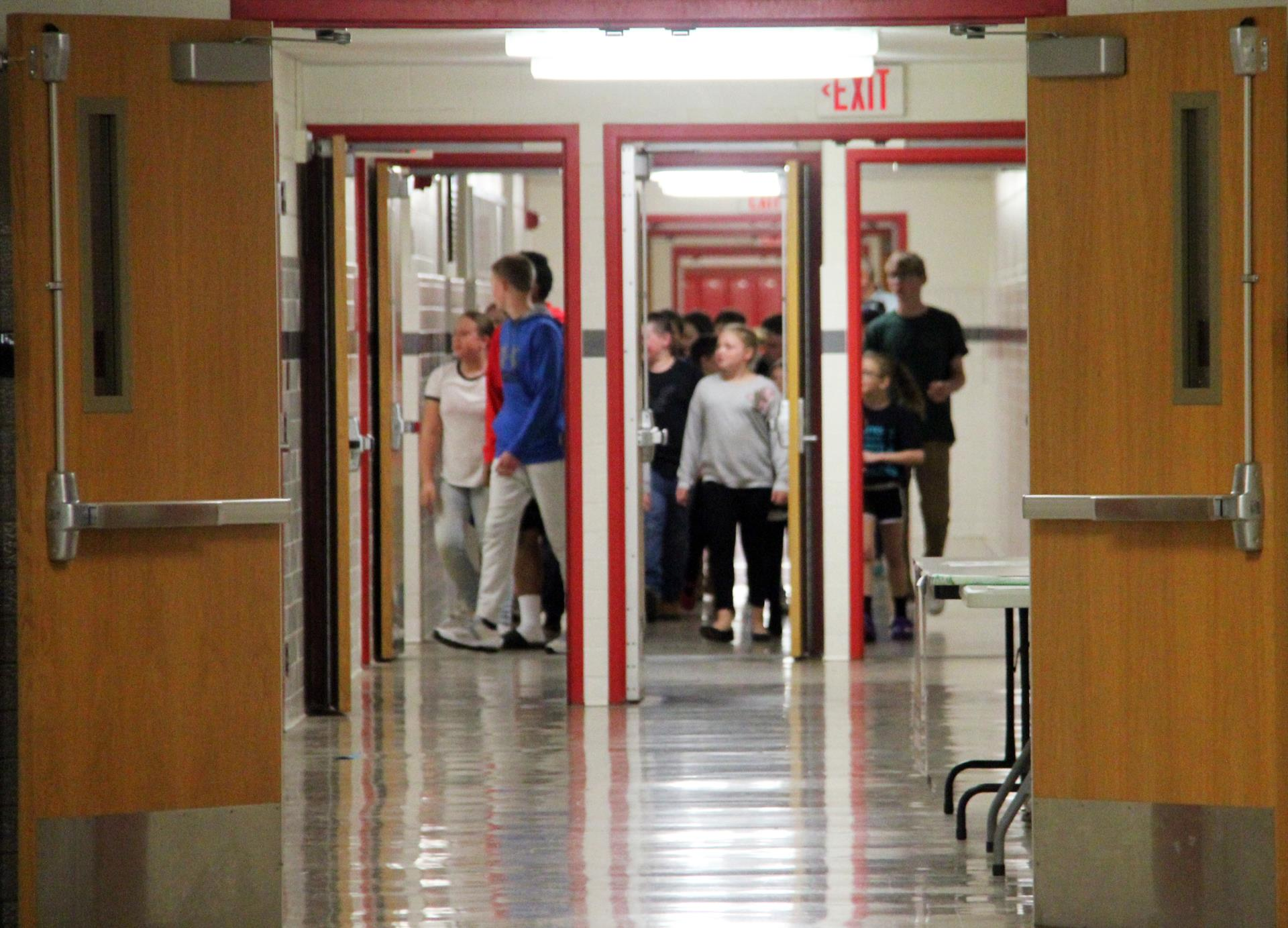 additional students walking in hallway