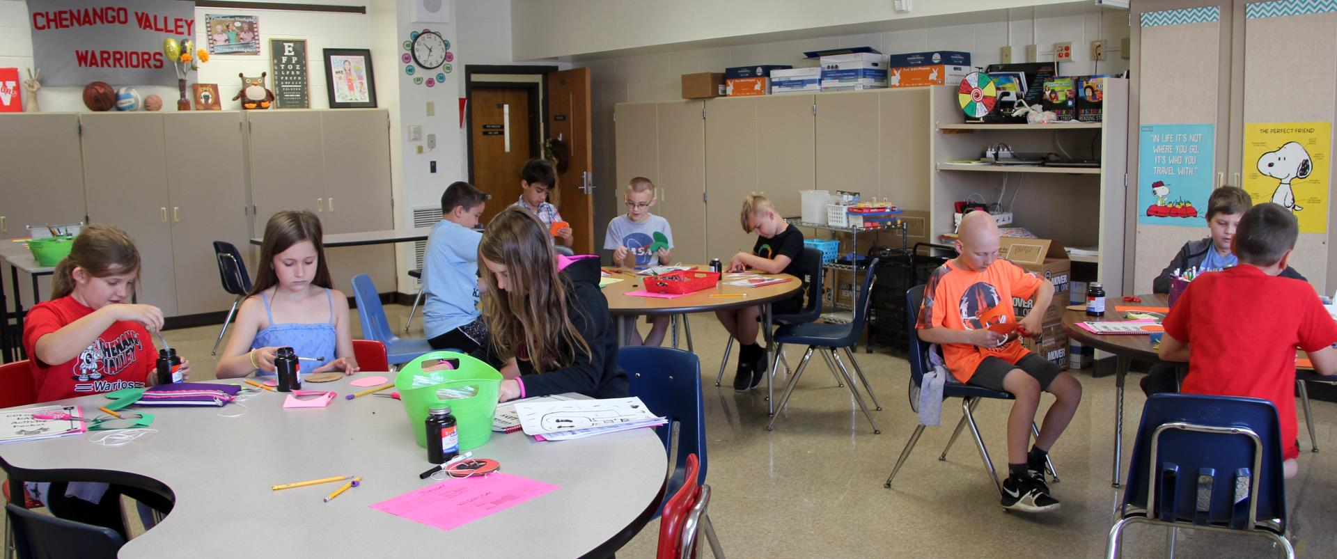 students in classroom designing whirligig toys