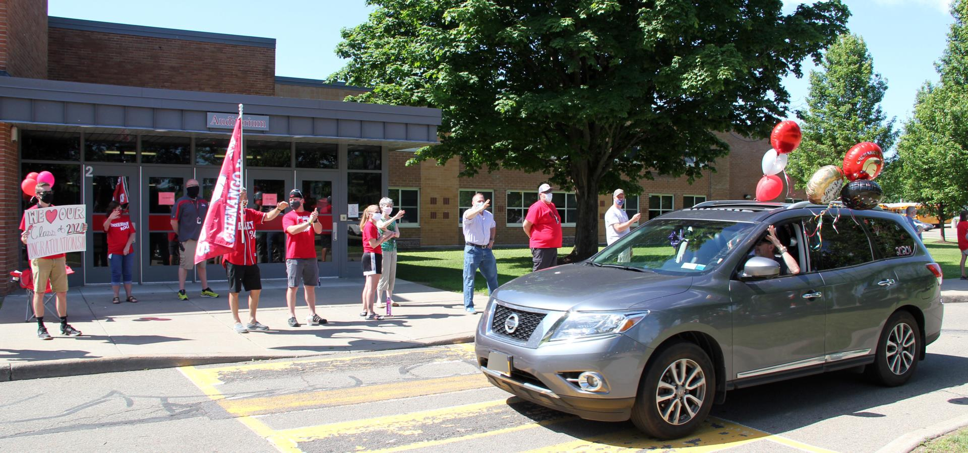teachers waving to car in parade
