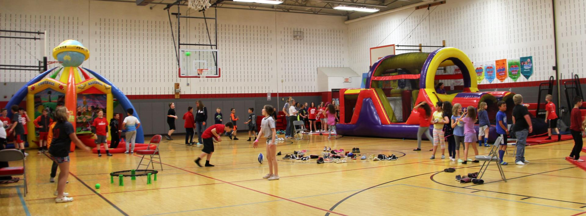 wide shot of carnival activities in gym