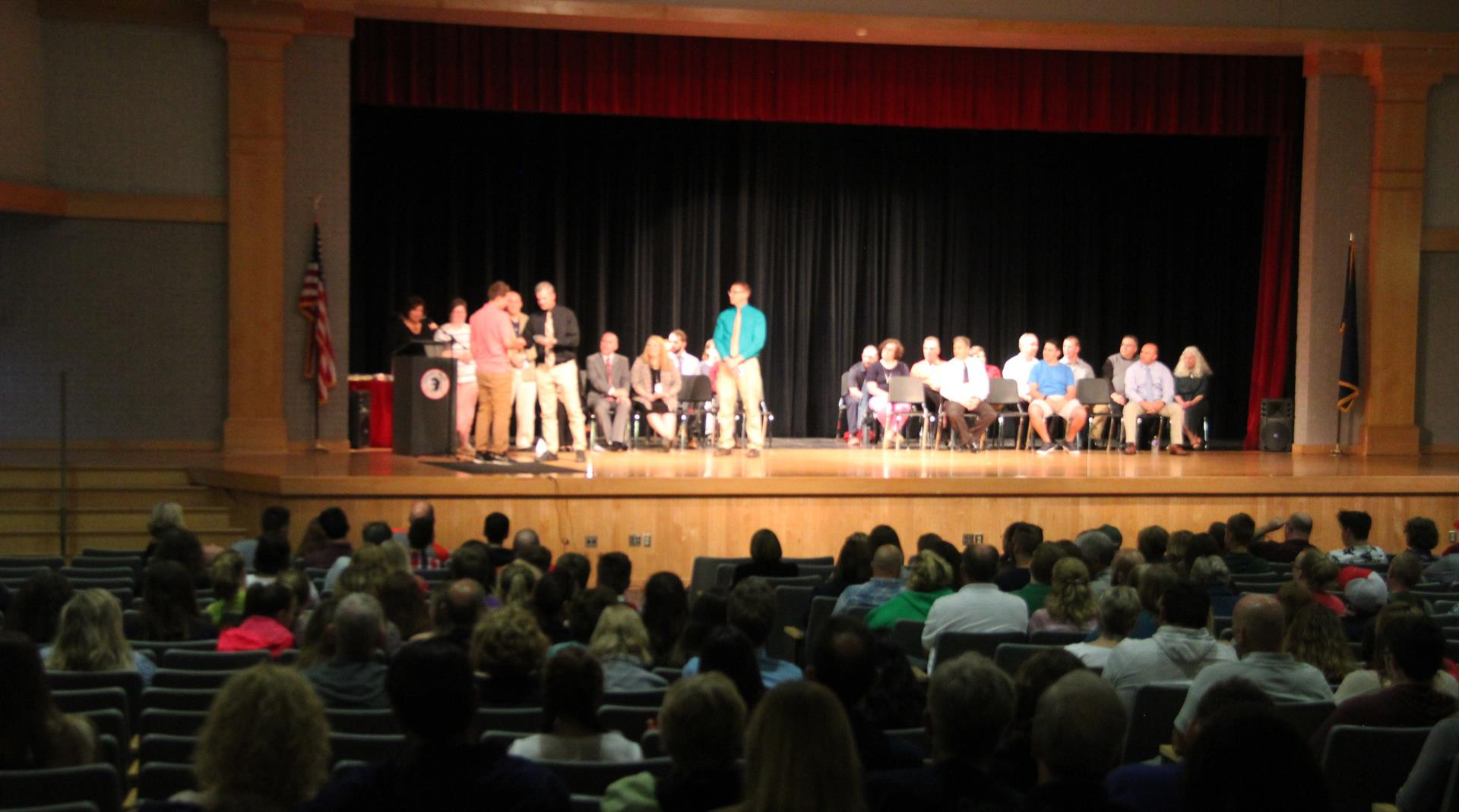 wide shot of high school awards ceremony