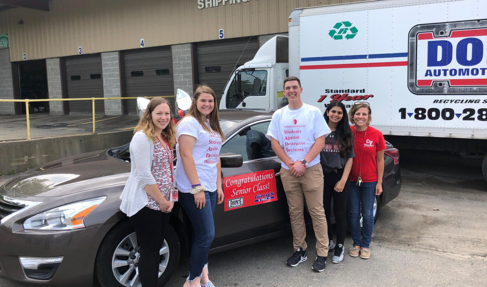 sadd members and advisors in front of car