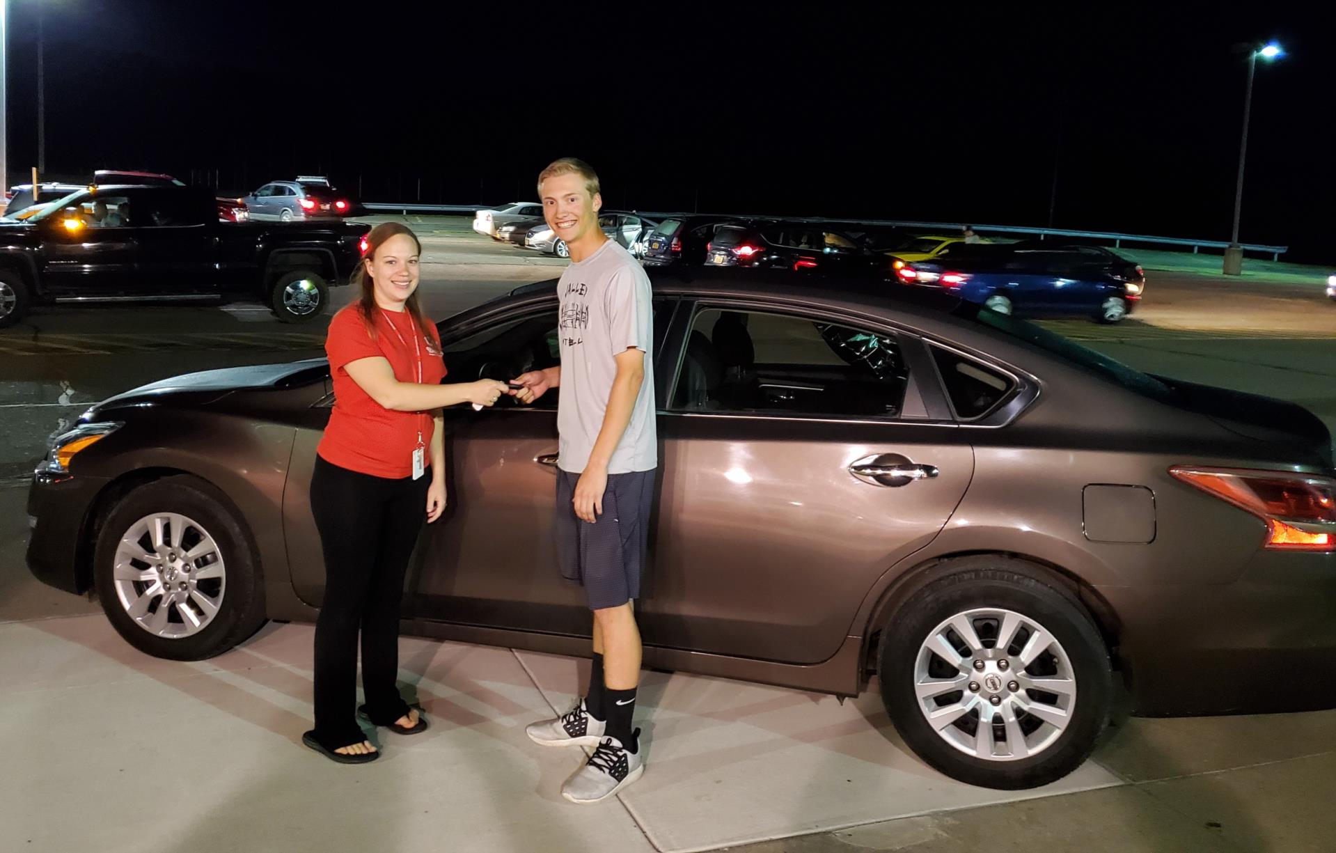 student being handed keys to car