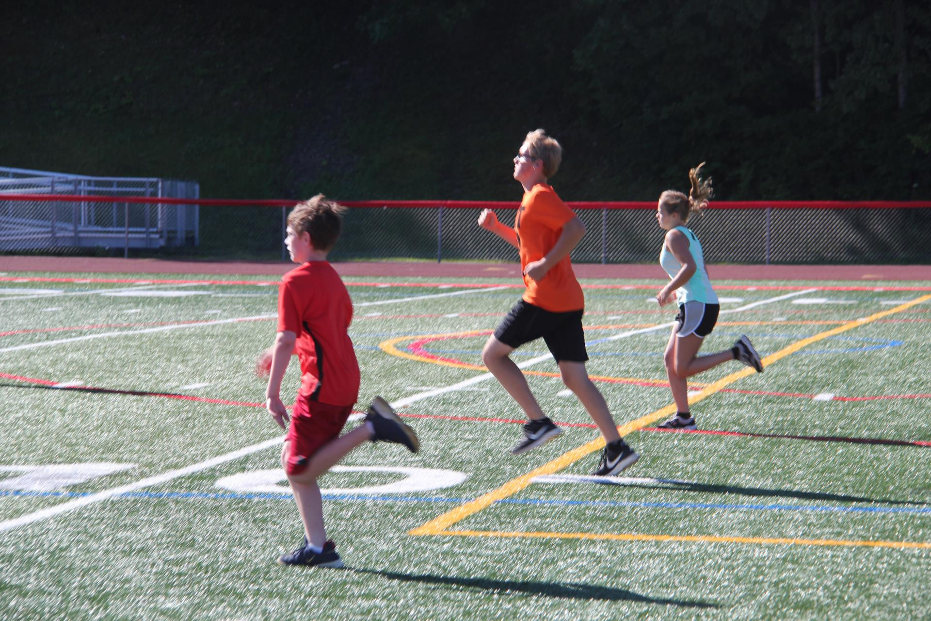 three students running