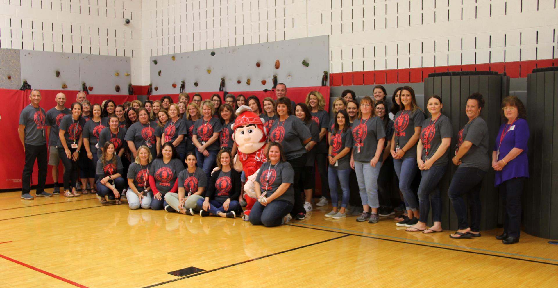 faculty and staff members wearing c v p 2 shirts